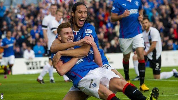 Bilel Mohsni congratulates fellow Rangers scorer Lewis Macleod