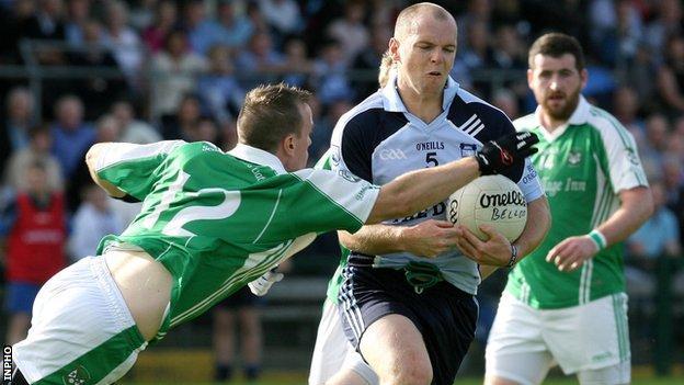 Belcoo's Declan Leonard challenges Peter Lynch in the final