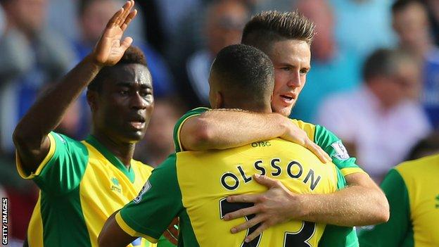 Ricky van Wolfswinkel is congratulated by team-mates for his part in the goal against Chelsea