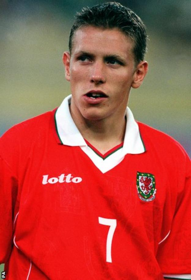 The young Norwich City striker is handed a start against Italy in Bologna in June 1999 but Wales lose 4-0 and Bobby Gould steps down as manager,