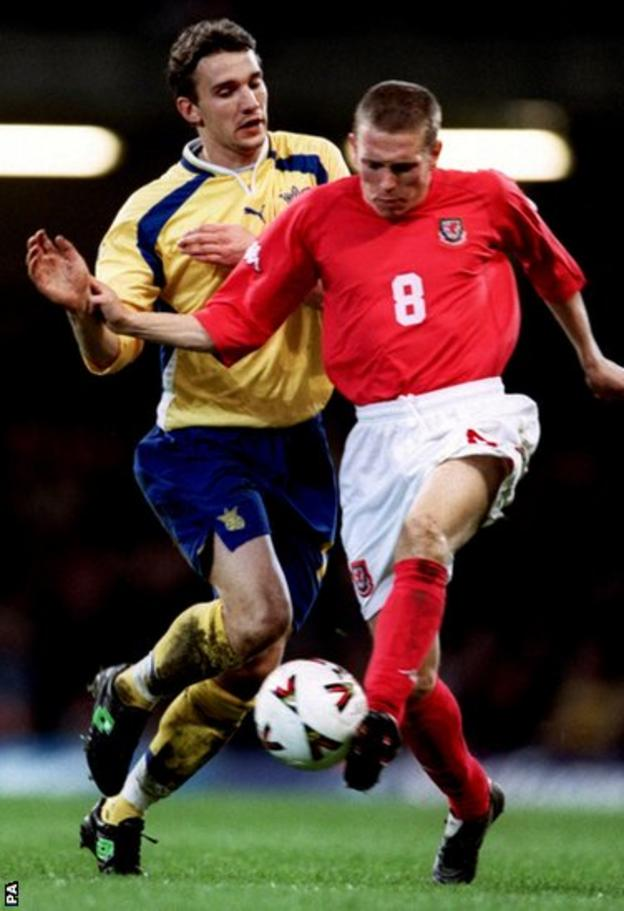 Wales make steady, if unspectacular progress, under Mark Hughes in the 2002 World Cup qualifiers with Bellamy in action against Ukraine's Andriy Shevchenko