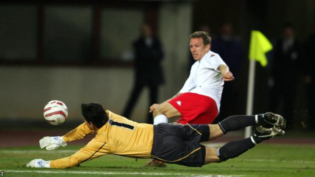 Austria goalkeeper Helge Payer saves at the feet of Bellamy as Wales fall to an unlucky 1-0 defeat in a World Cup qualifier in Vienna