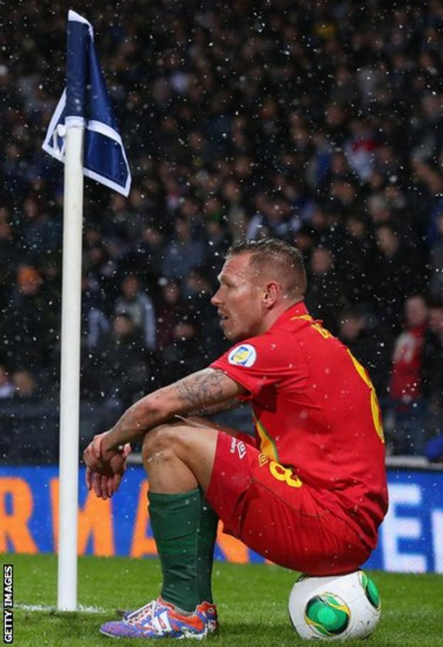 Bellamy takes a breather during Wales' 2-1 win over Scotland at Hampden Park in March 2013
