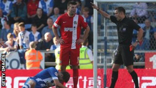 Blackburn's Grant Hanley is sent off at Wigan on Sunday