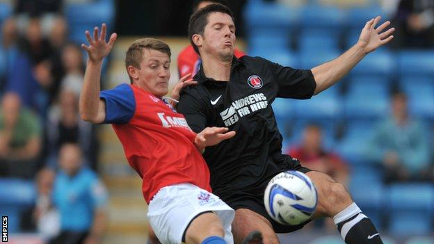 Callum Davies (left) and Charlton's Yann Kermorgant