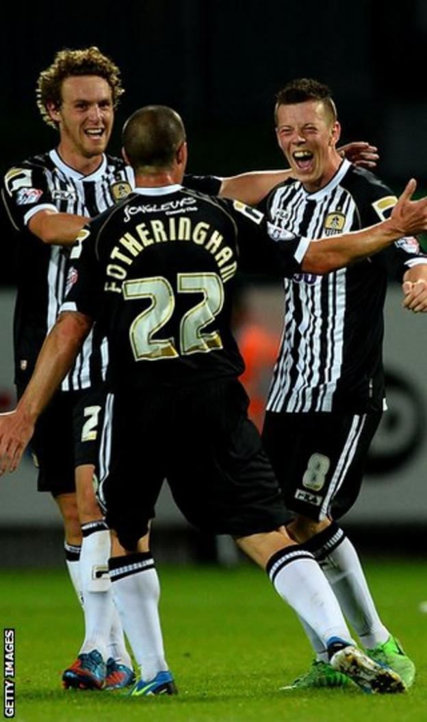 Former Celtic midfielder Mark Fotheringham congratulates Callum McGregor against Fleetwood Town