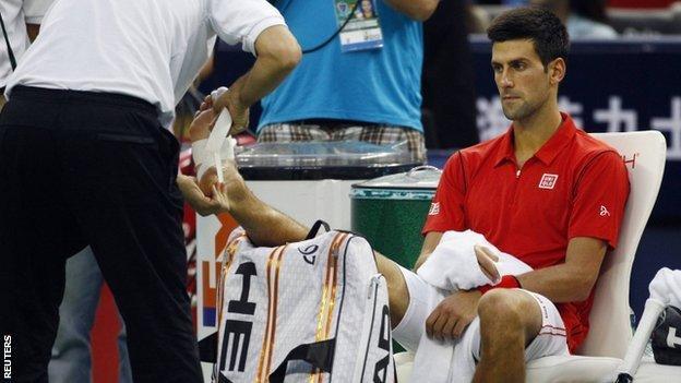 Novak Djokovic gets treatment for his injury in Shanghai
