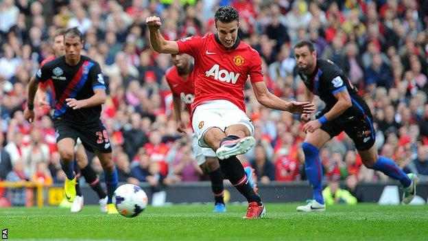 Manchester United's Robin van Persie scores from the penalty spot against Crystal Palace at Old Trafford