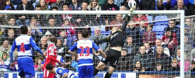 Goalkeeper Robert Green makes a save for QPR