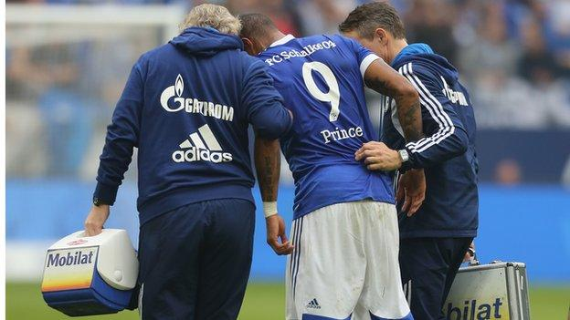 Kevin-Prince Boateng (centre) is helped off the field