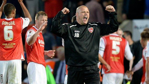 Morecambe manager Jim Bentley celebrates