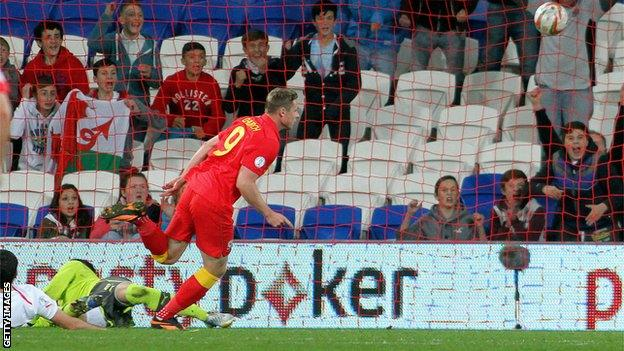 Simon Church scores the second half winner against Macedonia in Cardiff