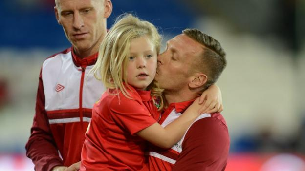 Craig Bellamy embraces daughter Lexie ahead of his final Wales home game, against Macedonia