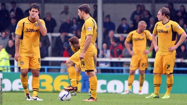 Newport County players get ready to restart the game after Bastien Hery scored Rochdale's third goal to secure a 3-0 win.