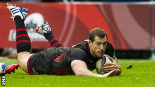 Edinburgh Rugby's Tim Visser slides in to score his side's second try of the game against Munster