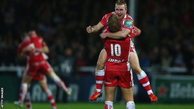Dan Robson and Billy Twelvetrees celebrate Gloucester's win over Perpignan