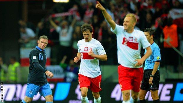Wayne Rooney dejected as Poland celebrate