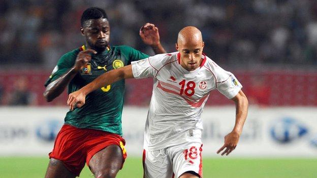 Cameroon's Alex Song and Tunisia's Yassin Mikari