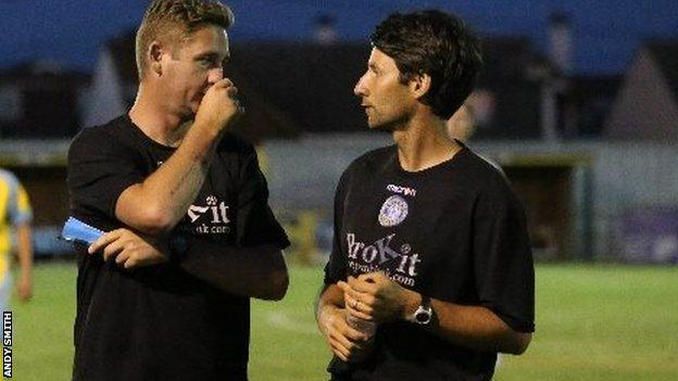 Danny Cowley talks to his staff at a Concord Rangers game