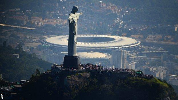 The iconic Christ the Redeemer statue in Rio with the Maracana below