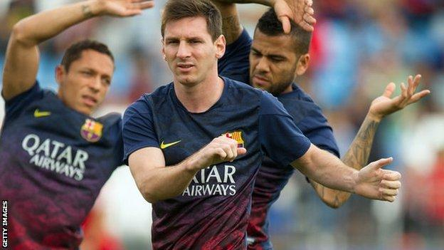 Lionel Messi (centre) during training for Barcelona