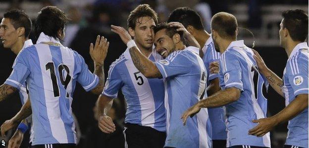 Argentina celebrate scoring against Peru