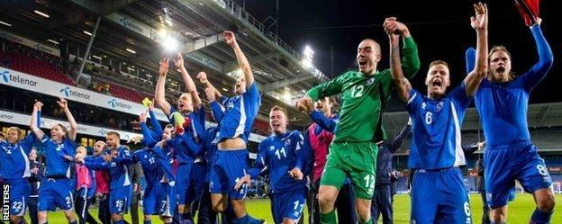 Iceland's players celebrate after reaching the play-offs