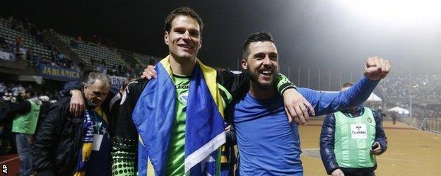 Asmir Begovic, left, and Haris Medunjanin celebrate Bosnia-Hercegovina's qualification