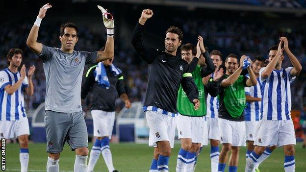 Real Sociedad players celebrating on the pitch following their 2nd leg win against Lyon