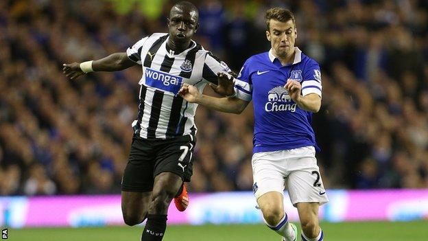 Moussa Sissoko (left) jostles with Everton's Seamus Coleman
