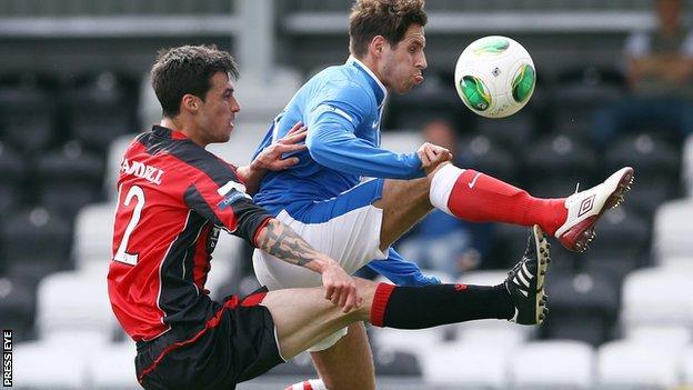 Crusaders midfielder Declan Caddell challenges Sean ward of Linfield