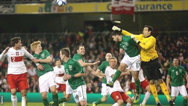 Republic keeper David Forde punches clear in February's game against Poland
