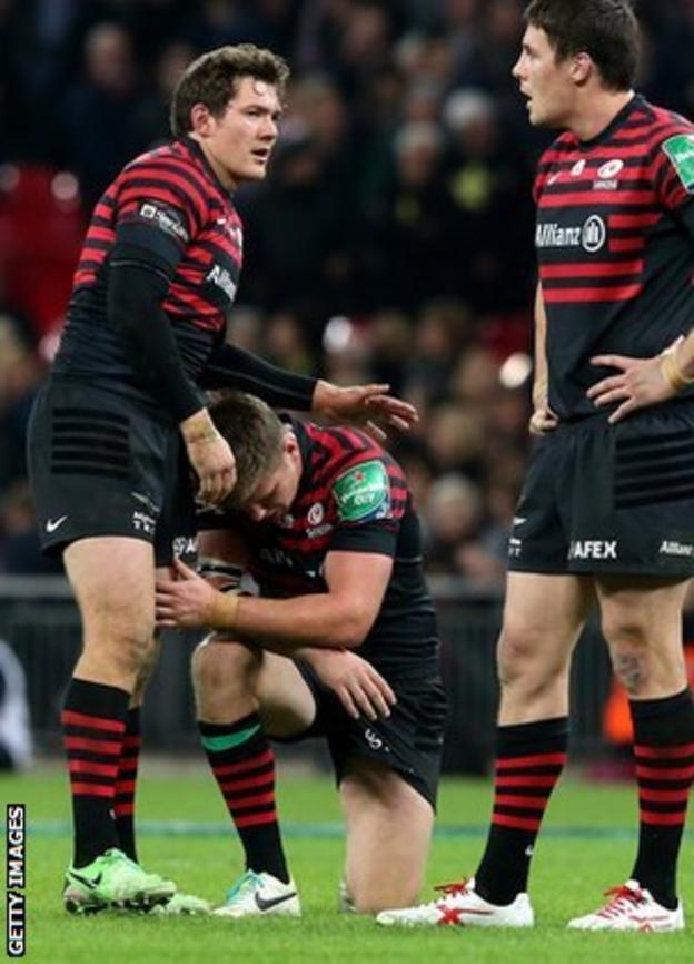 Farrell (centre) kneels is despair after his drop-goal to clinch victory fell short