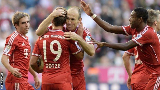 Bayern Munich players celebrate after scoring against Mainz