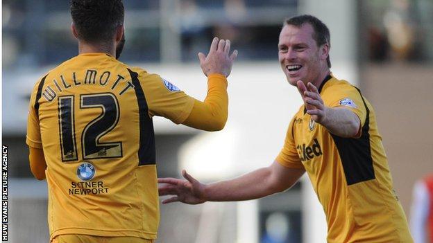 Robbie Willmott and Michael Flynn celebrate Newport's third goal