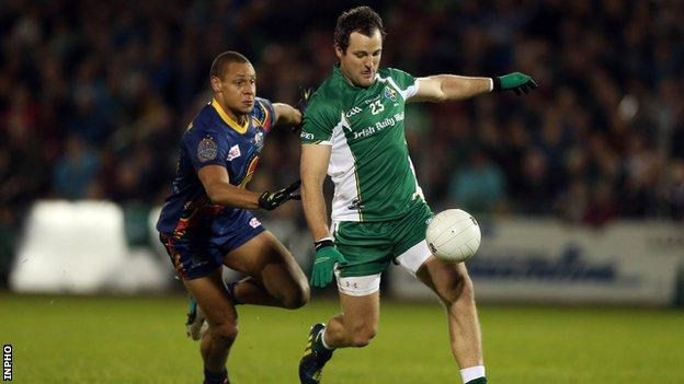 Ireland captain Michael Murphy is chased by Australia's Cameron Ellis-Yolmen