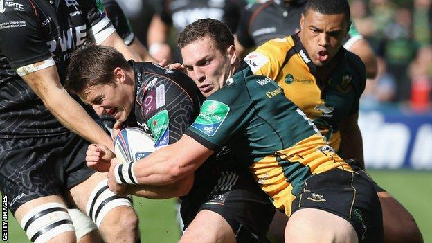 Ospreys' Jeff Hassler is held by George North