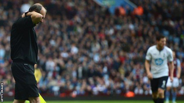 Linesman David Bryan who was hit by a flare during the Aston Villa v Tottenham Hotspur match.