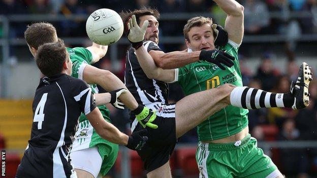 Burren's Eoin McCartan competes against Aidan Branagan of Kilcoo