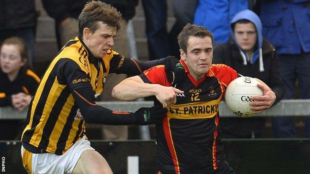 Crossmaglen's Paul Hughes tackles Eugene Casey of Cullyhanna