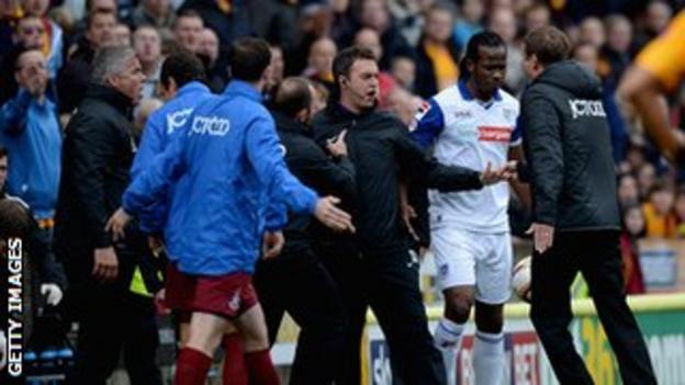 Bradford manager Phil Parkinson confronts Tranmere defender Ian Goodison