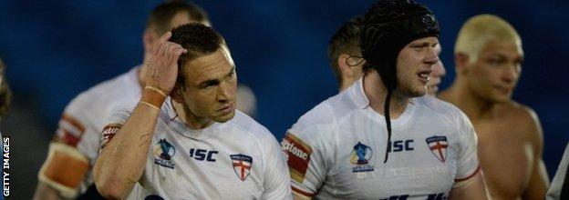 England captain Kevin Sinfield (left) shows his disappointment after his team's defeat against Italy