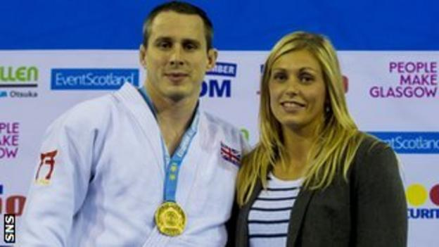 Burton's medal was presented to him by his wife, Olympic silver medallist Gemma Gibbons