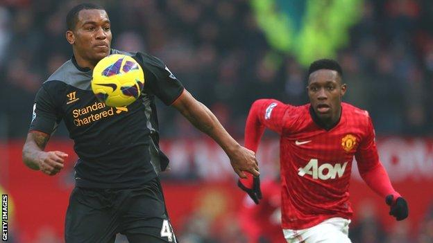 Liverpool's Andre Wisdom shields possession from Manchester United's Danny Wellbeck