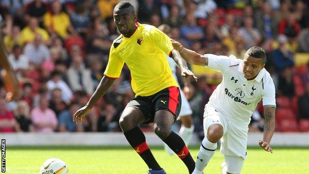Watford's Prince Buaben (left) grapples with Spurs' Jermaine Jenas