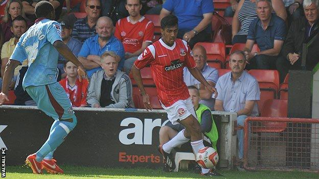 Walsall left-back Malvind Benning (right) in action