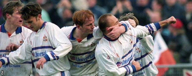 John Hartson (centre) celebrates a Luton goal at Cardiff in 1995