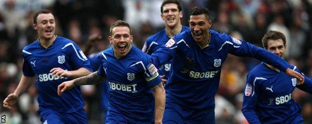 Craig Bellamy and team-mates celebrate