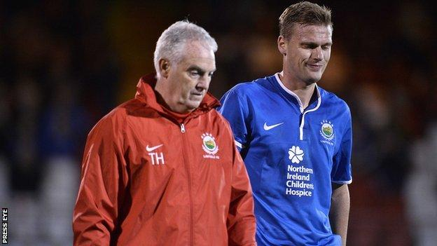 Linfield physio Terry Hayes with striker Peter Thompson