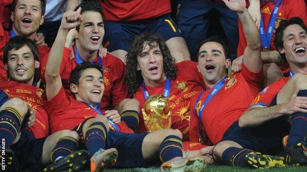 Spain pose with the world Cup after winning it in South Africa in 2010